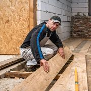 man working with wood at the construction site