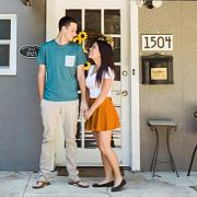 couple smiling at the font door